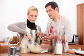 Couple making a cake together — Stock Photo