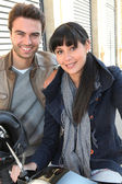 Young couple smiling in the street — Stock Photo