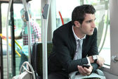 Man riding tram to work — Stock Photo