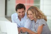Couple at work on laptops — Stock Photo