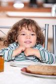 Little girl having crepes for dinner — Stock Photo