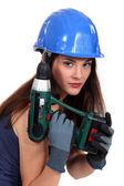 Pretty girl with screwdriver — Stock Photo