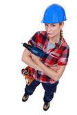 Aggressive female builder holding drill — Stock Photo