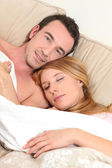 Embraced couple in bed — Stock Photo