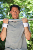 Man doing chin-ups — Stock Photo