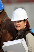 Businesswoman on a construction site — Stock Photo