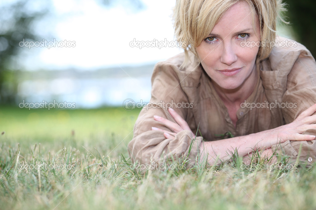 Woman lying on the grass  Stock Photo #8754138
