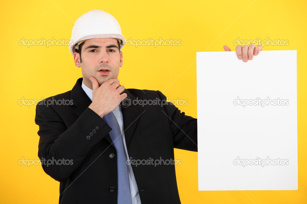 Businessman in a hardhat with a board left blank for your message — Stock Photo #8755402