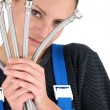 Stock Photo: Female plumber with flexible hoses
