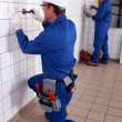 Male and female electricians at work — Stock Photo