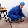Stock Photo: Professional repairmworking on wall