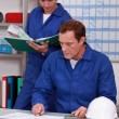 Manual workers in an office - Stock Photo