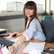 Woman working in her office — Stock Photo