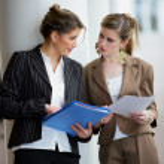 Businesswomen discussing documents — Stock Photo