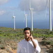 Man with laptop stood by wind farm — Stock Photo #8771809