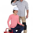 An electrician and his apprentice. — Stock Photo