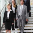 Group of colleagues descending stairs — Stockfoto