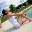 Young woman relaxing by the pool — Stock Photo #8772466