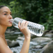 Woman drinking from water bottle — Stock Photo