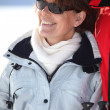 A smiling mature woman in a winter sports resort — Foto de Stock
