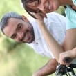 Couple riding their bikes together — Stock Photo