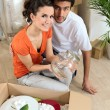 Young couple in their new apartment — Stock Photo #8773473