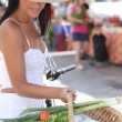 Woman with a bike and basket of market produce — Stock Photo