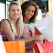 Stock Photo: Two beautiful girls shopping
