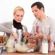 Stock Photo: Couple making cake together