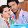 Couple recycling plastic bottles — Stock Photo