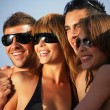 Youth group on the beach — Stock Photo