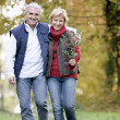 Couple taking leisurely walk — Stock Photo
