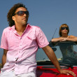 Stock Photo: Couple posing with their car