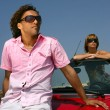 Couple posing with their car — Stock Photo