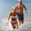 Cheerful couple bathing in the sea — Stock Photo