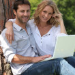 Couple with laptop — Stock Photo #8777542