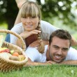 Stock Photo: Couple having picnic in woods