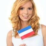 Girl holding Dutch flag — Stock Photo