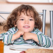 Stock Photo: Little girl having crepes for dinner