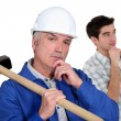 Builder and teenager deep in thought - Stock Photo