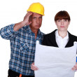 Stock Photo: Stressed architect and foreman