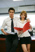 Two young business with folders — Stock Photo