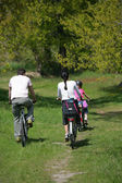 Family bike ride — Stock Photo