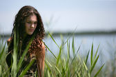 Brunette stood by lake — Stock Photo