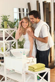 Young couple preparing in bathroom — Stock Photo