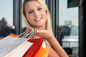 A blonde woman doing shopping — Stock Photo