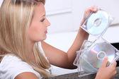 Teenage girl looking at CDs — Stock Photo