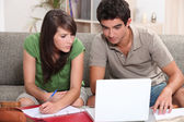 Young couple using a laptop computer — Stock Photo