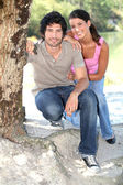 Portrait of a couple by the river — Stock Photo