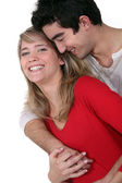 Young couple hugging in studio — Stock Photo